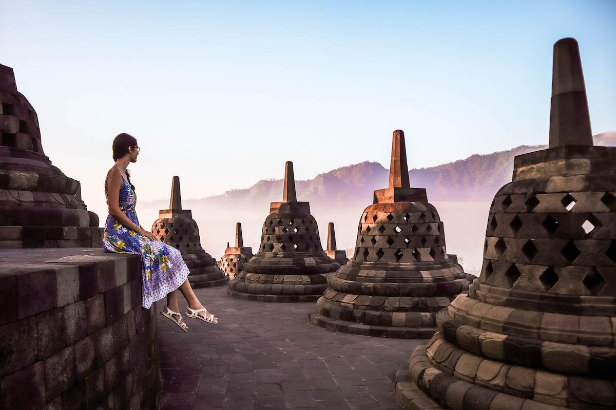 Aurelia Teslaru at Borobudur Temple at sunrise. Beautiful sunrise at Borobudur.