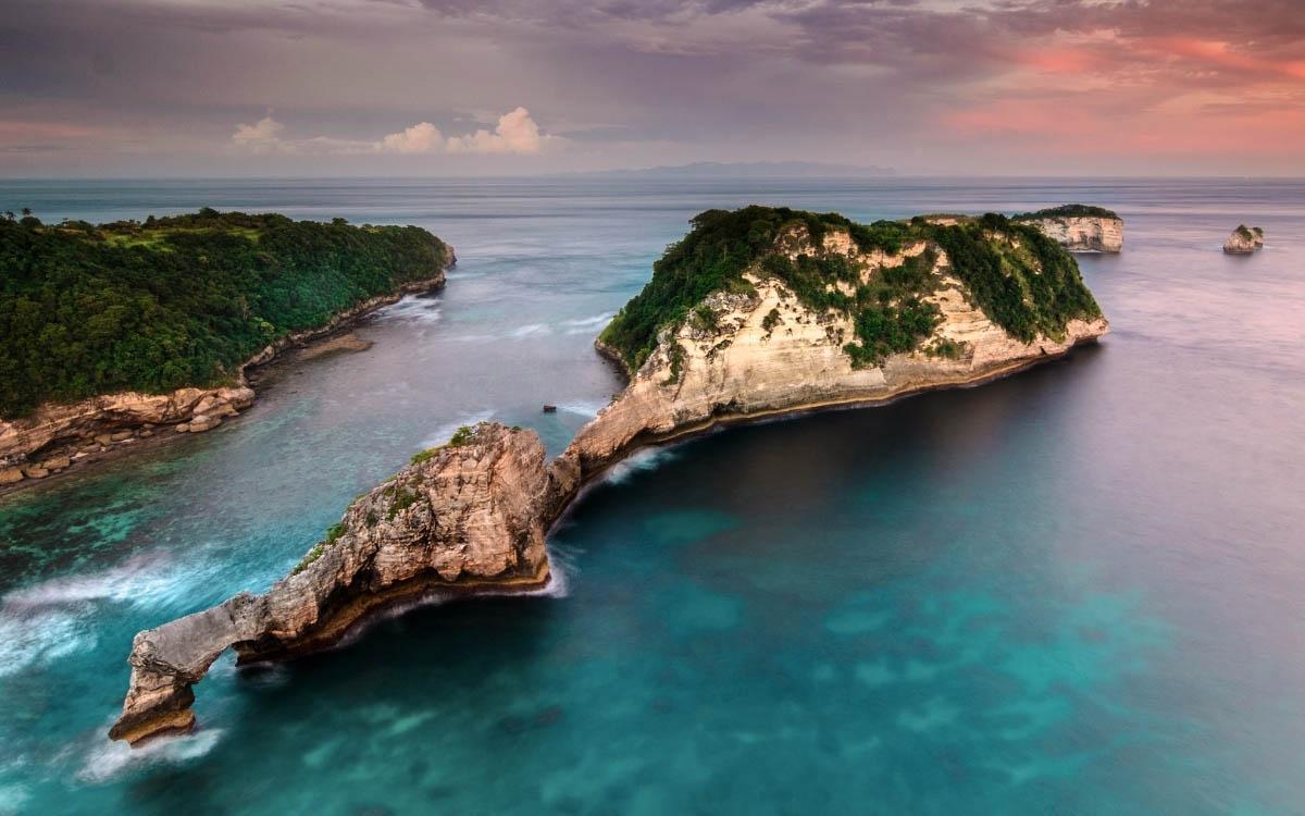 Atuh Beach Nusa Penida broken limestone cliff