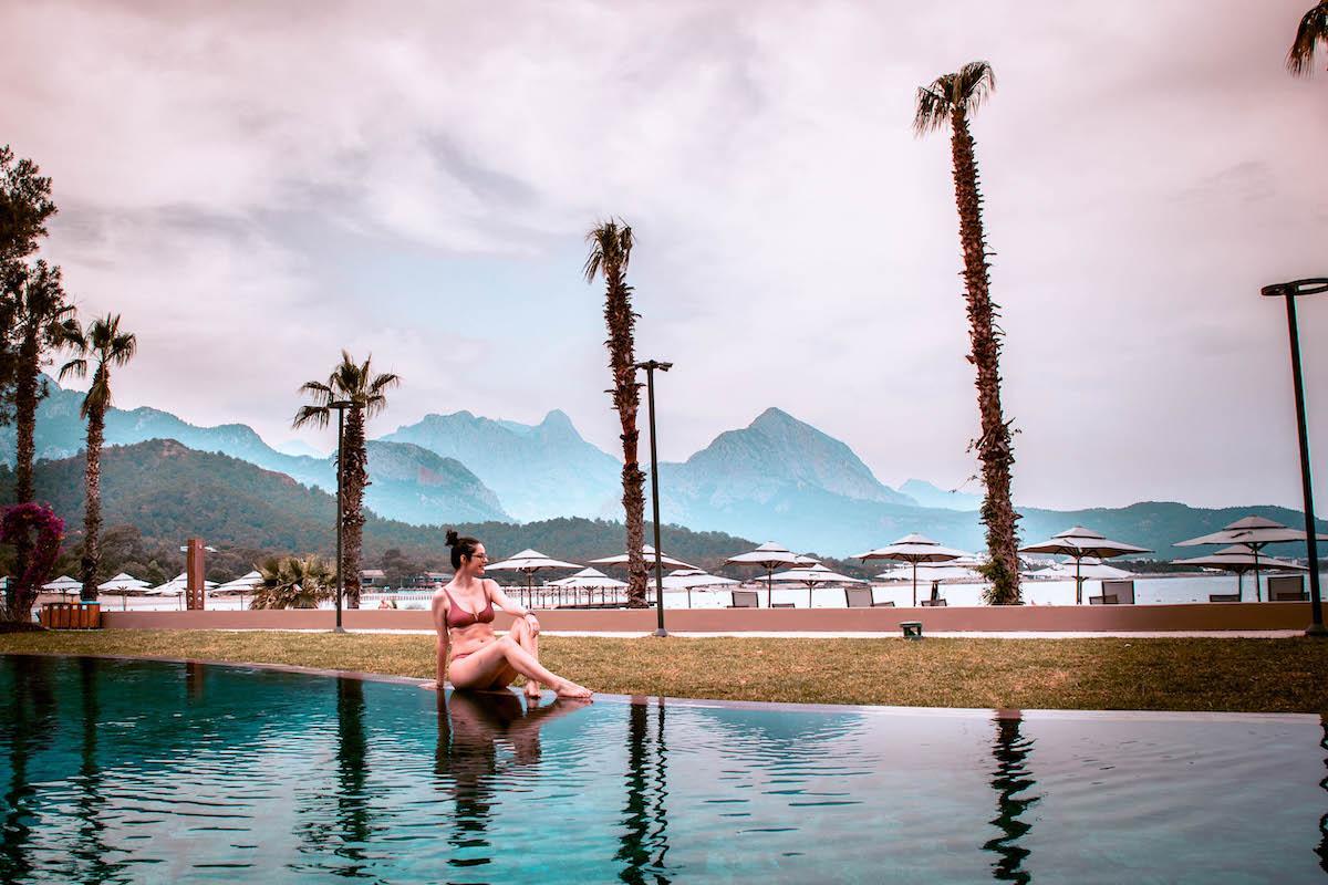 Ng Phaselis Bay Hotel Antalya heated pool and palm trees
